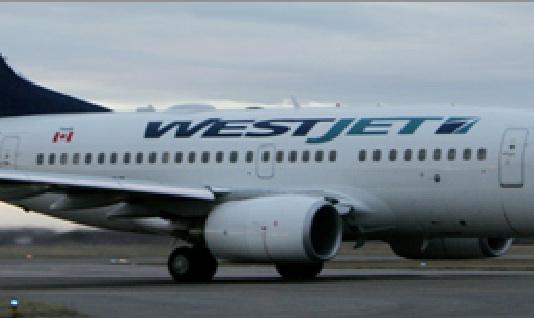 Un avion de WestJet atterrit d'urgence à Winnipeg suite à une menace : Six personnes blessées